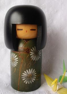 Vintage Kokeshi Doll in olive green.