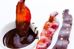 """Is your 2015 resolution to """"eat more bacon""""?  Well, PL&C can help with that! Maple-smoked Candied Bacon, dipped in chocolate and garnished with sea salt - pick up a pack today and start your New Year off right!  #chocolate #bacon #candiedbacon #seasalt #omnomnom"""