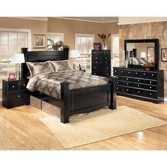The Shay Bedroom Collection brings together a rich dark finish with the sophisticated detailing to create furniture that is sure to awaken the decor of any bedroom with stylish contemporary flair. The contemporary replicated almost-black paint finish features a rich merlot undercoat which flows beautifully over the Swooping shaped base rails and the straight-lined design with wide segmented details framing the bed and mirror. Adorned perfectly with the complementing satin nickel color…