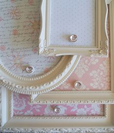 Cut down old cookie sheet with tin snips, cover with scrapbook paper, and put into an old, repainted frame