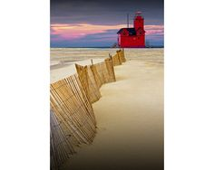 Big Red Lighthouse with Dune Fence at the Lake Michigan Shore