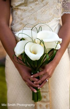 Calla Lilies, bear grass & lily grass White bouquets for the bridesmaids and their dress colour for the bride?