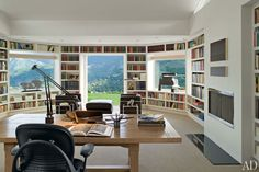 At a house she remodeled in California's Carmel Valley, designer Sally Sirkin Lewis encircled the library with shelves, added French doors to bring in views of the lush landscape, and outfitted the space with Le Corbusier Grand Confort armchairs. The Best Home Libraries from the Pages of AD : Interiors + Inspiration : Architectural Digest