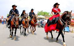 Ecuador. Salitre (Guayas). Day of the Montubios,  Montubio is how the mestizo people of Ecuador's lowlands call themselves. Before the rodeo, the participating teams ride through town, their high-spirited female leaders first.  victorenglebertphotography
