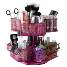 """Rotating cosmetics carousel in rose.   Product: Cosmetic carouselConstruction Material: MetalColor: RoseFeatures:   Holds all sizes of cosmeticsBase rotates 360 degrees Dimensions: 8.25"""" H x 9"""" Diameter"""