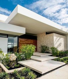 What do you think of this beautiful house? Swipe left to see more ⬅️ - Casa RM is a modern residence and a tropical safe-space. The home is designed by Located in Merida, Mexico🇲🇽 Photos Architecture Design, Modern Architecture House, Facade Design, Modern House Design, Exterior Design, Exterior Paint, House Entrance, Entrance Ideas, Facade House