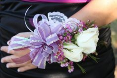 Corsage: White flowers with purple ribbon