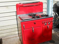 Vintage Red Chambers gas stove  Want it...you could build your kitchen around this stove...Hmmm Good