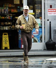 Shia LaBeouf braves the rain to grab a cup of coffee to-go at a gas station in Sherman Oaks before going back home http://www.icelebz.com/events/shia_labeouf_braves_the_rain_to_grab_a_cup_of_coffee_to-go_at_a_gas_station_in_sherman_oaks_before_going_back_home/