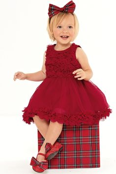 BABY TRINITY'S OUTFIT. So she had the cute novelty sleepsuit for Christmas eve and Christmas morning - but for Christmas day, she needs to look her best. Instead of wearing so many hand-me-down blue vests from her two brothers - it would be time for something spectacular and this dress is it! My little lady in red!   Buy Red Flower Party Dress from the Next UK online shop