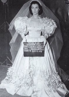 Vivien Leigh as Scarlett O'Hara Hamilton in a wardrobe still of her wedding dress in 'Gone With The Wind'.