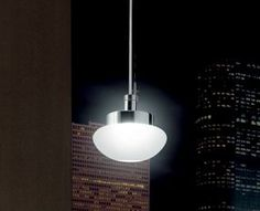"""ONY S - <p style=""""text-align: justify;""""> This small scale pendant features a hand-poured glass diffuser that provides both downward as well as diffused illumination. Two glass options and finishes are offered: crystal and frosted white. Glass diffuser is supported by a clear cord and a polished chrome or brushed nickel metal canopy. Companion recessed design also available.</p>"""