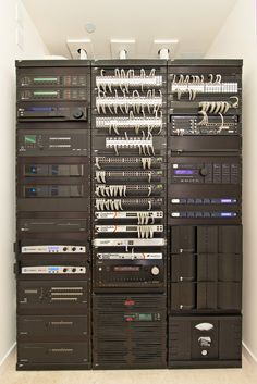 Impressive home theater/home automation equipment rack! More photos: http://www.cedia.org/inspiration-gallery/kick-back-and-relax