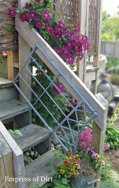 Old garden arbor gate repurposed as a railing and clematis trellis ~ Empress of Dirt