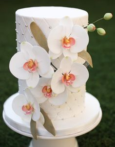 Pretty white cake with orchids
