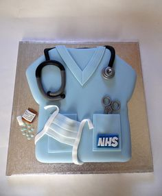 We made this cake for an NHS Hospital Doctor for his retirement, apparently the pills looked realistic so I'm told! www.fairydustbakery.co.uk     FREE-BOOK ON OBAMACARE CAN BE DOWNLOADED Athttp://medaccessusa.com/