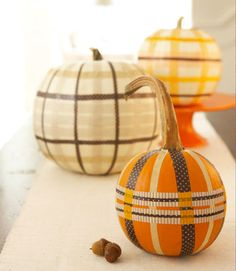 Easy no-carve pumpkin ideas: Cool washi tape plaid effect via Good Housekeeping