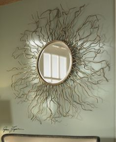sonoran large sunburst mirror, large sunburst mirror is made of hand forged metal tubes finished in a lightly antiqued gold