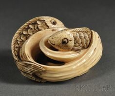 Ivory Netsuke, Japan, carved as two fish in swirling waves, lg. 1 3/4 in.