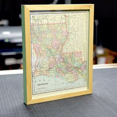 We hated to see this one leave.  Vintage Louisiana map framed in two-tone green basswood.