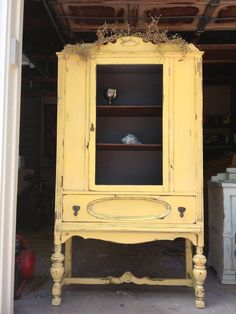 Yellow vintage china cabinet with gray interior