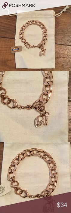 Fossil rose gold chain bracelet NWT! Fossil rose gold chain bracelet with heart lock and key charms. Never worn. Make me an offer! Fossil Jewelry Bracelets