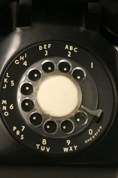 A traditional North American rotary phone dial. The associative lettering was originally used for dialing named exchanges, but was kept because it facilitated memorization of telephone numbers.  Rotary dial - Wikipedia, the free encyclopedia
