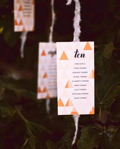 Escort cards, dangling on frayed strips of gray linen tied to the branches of a lush fig tree just outside the dining room, informed loved ones of their table numbers.