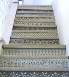 Im sure I could decoupage scrap booking paper to the front of my stairs....