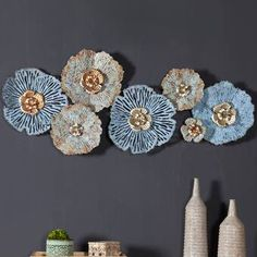 Bloomsbury Market This is a beautiful wall décor in lovely distressed blue and gold tones. It makes an impressive statement that is perfect for any living space in your home.