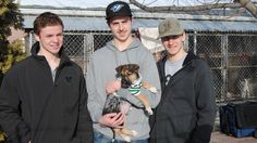 Josh Morrissey, Shane Danyluk and Carson Perreaux with Raider, the dog they helped rescue