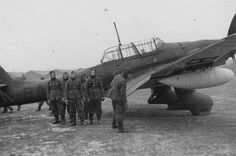 German soldiers at the dive-bomber Junkers Ju-87R at the airport in France