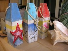Up-cycled lumber custom painted nautical buoys. Beach Crafts, Diy Crafts, Beachy Signs, Coastal Art, Coastal Cottage, Coastal Style, Coastal Living, Beach House Decor, Seaside Decor