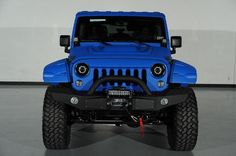 Custom 2014 Jeep Wrangler Unlimited in Cosmo Blue Exterior: Custom Hood and Light Bar