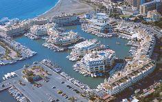 """Puerto Deportivo de """"Benalmádena"""" (Málaga).. También conocido como Puerto Marina.. Es un puerto marítimo situado en la costa mediterránea española, en el municipio malagueño de Benalmádena.. Es uno de los lugares más emblemáticos y visitados de la Costa del Sol.. Fue inaugurado en 1979 con el nombre de Puerto Príncipe y en el 1982 se inauguró como Puerto Marina.. Malaga, Benalmadena Spain, Andalusia, Birds Eye View, New Perspective, Costa, City Photo, Travel Destinations, Water"""