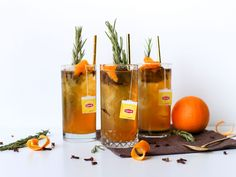 Orange Pomander Iced Tea : Inspired by the pomander-ball school craft of sticking cloves into an orange to make a holiday ornament, this Orange Pomander Iced Tea is made with black tea (chai would work well too) and fresh-squeezed orange juice, served over ice with a rosemary stalk, cloves and an orange-peel twist.