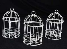 Birdcage candle holders as centerpieces! Cute and simple! :)