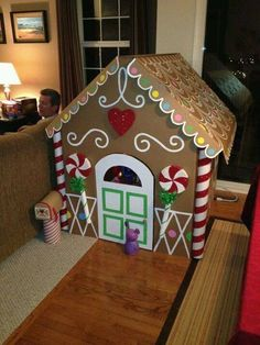 """Ginger Bread House:This Can Be Done W/Duct Tape Or Riveting Cardboard Boxes (Inside Out )Together & Cut In The Shape Of A House (& Roof).Draw Paint /Designs As Shown In Picture.""""Candy Cane Corners"""": Tape Pringles Cans Together & Cover With Red & White Str Cardboard Gingerbread House, Christmas Gingerbread, Noel Christmas, All Things Christmas, Xmas, Gingerbread Houses, Gingerbread House Pictures, Gingerbread Decorations, Outdoor Christmas Decorations"""