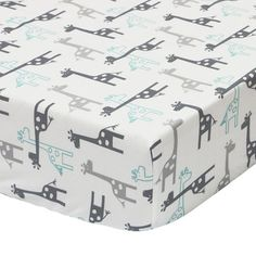 The Peanut Shell Uptown Giraffe fitted crib sheet is made from soft cotton sateen and features a contemporary giraffe print in grey and mint. Coordinates perfectly with the Peanut Shell Uptown Giraffe nursery collection. Baby Crib Sheets, Baby Nursery Bedding, Baby Boy Nurseries, Baby Cribs, Baby Rooms, Baby Bedroom, Kids Rooms, Uptown Giraffe Nursery, Safari Nursery