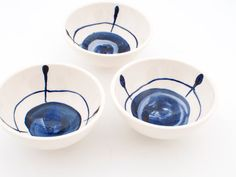 Set of three simple, modern, Delft blue hand painted earthenware ceramic little bowls