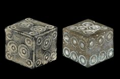 Ancient & Medieval History      Roman Bronze Dice, c. 1st-3rd century AD      A pair of cuboid dice comprising: one with two large ring-and-dot motifs to each face and a smaller in each corner; one with six ring-and-dot motifs to four of its faces, one with five and another with six irregularly spaced.