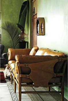 Leather couch and polished plaster walls.