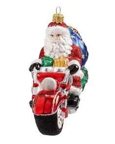 This fanciful Motorcycle Santa Blown Glass Ornament is on the road to spread some Christmas cheer!