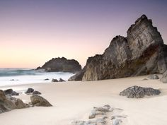 Why we love it: This stunning, semi-remote beach in Sintra-Cascais Natural Park, approximately one hour from Lisbon, is worth the trek for its surf—and sunsets.