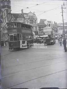 Tram going past clock tower, with busses and pedestrians beyond; policeman directing traffic to right: glass plate negative, Leicestershire Record Office Leicester, Northern Ireland, Historical Photos, Great Britain, Old Houses, Tower, Street View, Clock, Busses