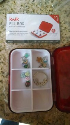 Cheap storage for my Origami Owl charms! I bought this pull box at Targets dollar spot for $1