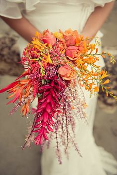 Pink and orange cascading bouquet. Gorgeous.