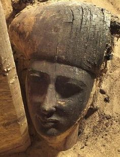 Stunning face hidden for thousands of years: The wooden sarcophagus was  unearthed by a team of archaeologists from the University of Jaen, in  Spain, who have been carrying out digs at at the necropolis of Qubbet  el-Hawa in Aswan, Egypt since 2008.