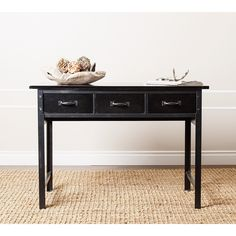 Functional and decorative, this Abbyson Living table makes a stylish addition to any room in your home. Booker console table lends transitional-inspired design with nailhead trim and an antiqued black finish. Three functional drawers complete the design.