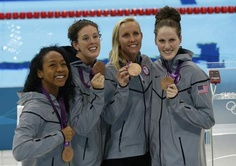 Members of the U.S. women's 4x100 freestyle relay team, from left, Lia Neal, Allison Schmitt, Jessica Hardy and Missy Franklin pose with their bronze medals in London, Saturday, July 28, 2012. (AP Photo/Daniel Ochoa De Olza)